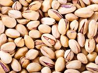 fresh pistachios as background