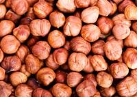 raw hazelnuts as background