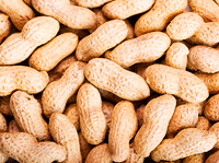 raw peanuts in shells as background