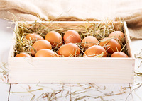 brown eggs in wooden box