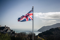 Union jack flag blowing in the wind on the English coast