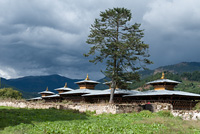Wangdichholing Palace with mountains in the background, Chokhor Valley, Bumthang District, Bhutan