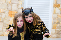 Halloween kid sister girls costume scaring gesture in outdoor