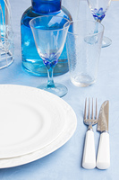 Tableware - set of plates, cups and utencils close up