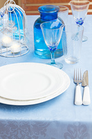 Tableware - set of white plates, cups and utencils close up