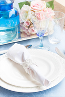 Tableware - set of plates, cups, utencils and flowers