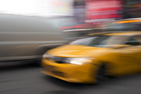 Blurred view of Yellow taxi moving in Times Square, Manhattan, New York City, New York State, USA