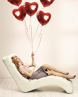 Alluring blonde woman preparing for valentine's day