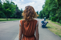 A young woman is walking in a park