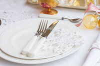 Tableware set. Tableware for christmas - set of plates and utencils on white tablecloth