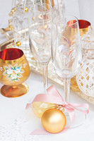 Tableware set. Tableware for christmas - two empty campagne glasses and christmas golden decorations