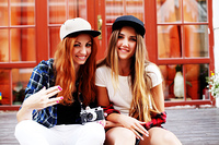 Two young pretty girls hanging out