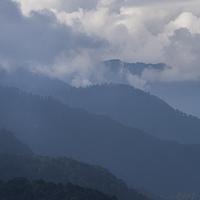 Fog over mountain range, Dochula Pass, Thimphu, Bhutan