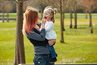 Mother and daughter playint together in the park