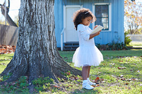 Kid toddler girl with tablet pc playing outdoor park latin ethnicity