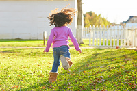 kid girl toddler playing running in park rear view latin ethnicity