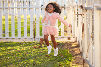 kid girl toddler playing jumping in park outdoor latin ethnicity