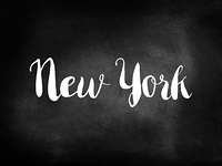 New York written on a chalkboard