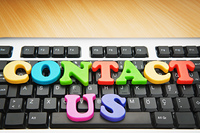 Contact us concept with letters on keyboard