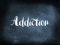 Addiction written on a blackboard