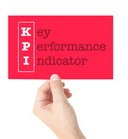 Key Performance Indicator explained on a card held by a hand