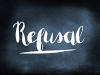 Refusal handwritten on a chalkboard