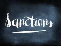 Sanctions handwritten on a chalkboard