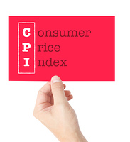 Consumer Price Index explained on a card held by a hand
