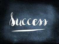 Success handwritten on a chalkboard