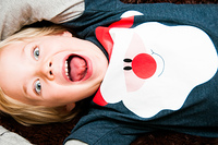Fun portrait of a boy in a Father Christmas T-shirt