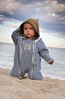 Portrait of a toddler in a sandy beach