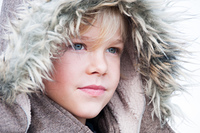 Portrait of a young boy in a fake fur hood