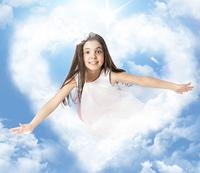 Little girl flying through a heartshaped cloud