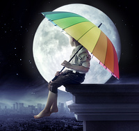 Little boy holding a colorful umbrella