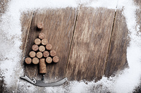 Christmas tree made of corks and corkscrew background on wooden table