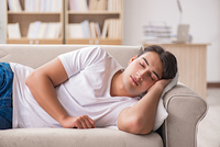 Young man sleeping in sofa couch