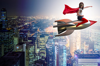 Little girl flying rocket in superhero concept