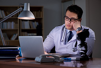 Young doctor working late in the office