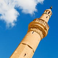 in iran blur islamic mausoleum old architecture mosque minaret near the sky