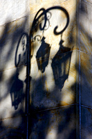 shadow of a street lamp and a yellow orange marble wall in la boca buenos aires argentina