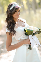 Portrait of beautiful bride outdoors in a forest