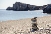 Pebbles in balancing on the sea coast