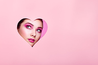 Conceptual photo of Valentine's day. Face of Girl with Festive Pink Makeup. Paper hearts on a pink background. Love symbols Valentines day