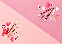 Valentine's Day Background. Red Hearts on a Pink background. Flat Lay. St.Valentine's Day Wallpaper. Make Up Brushes. Lipstick and nail Polish