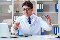 The doctor optician prescribing holding optical glasses . Doctor optician prescribing holding optical glasses