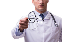 The eye doctor in medical concept isolated on white. Eye doctor in medical concept isolated on white