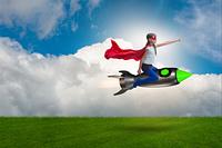 Little girl flying rocket in superhero concept