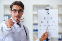 Eye doctor in medical concept