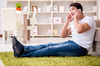 Young man student listening to music at home