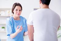 Patient visitng doctor for annual flu shot inoculation for prevention. Patient visitng doctor for annual flu shot inoculation for preve